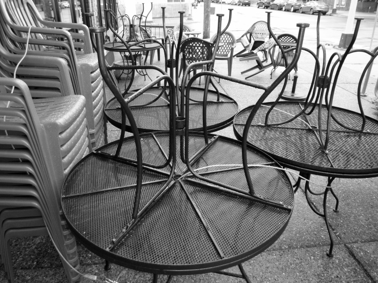 chairs_and_tables_tilted_up_in_rain_riverview_cafe_mpls_mn_19_bw_b15