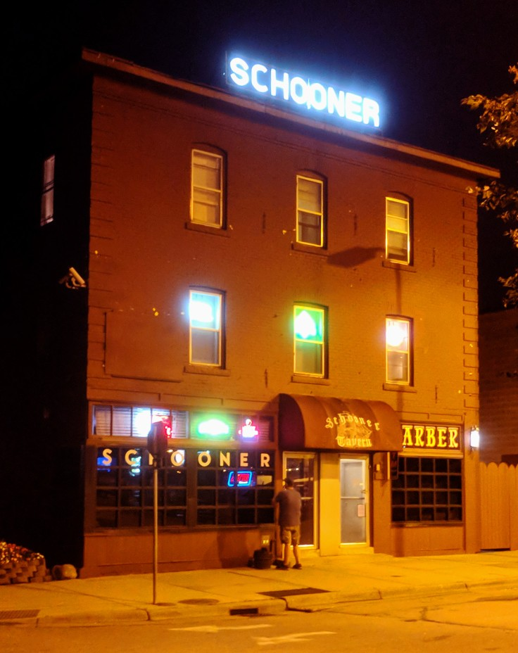 Schooner Tavern with sign lit at night