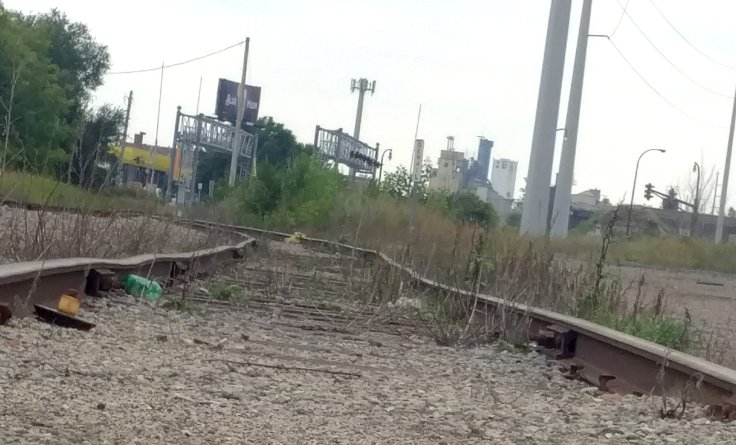 Railroad tracks to old grain towers in background