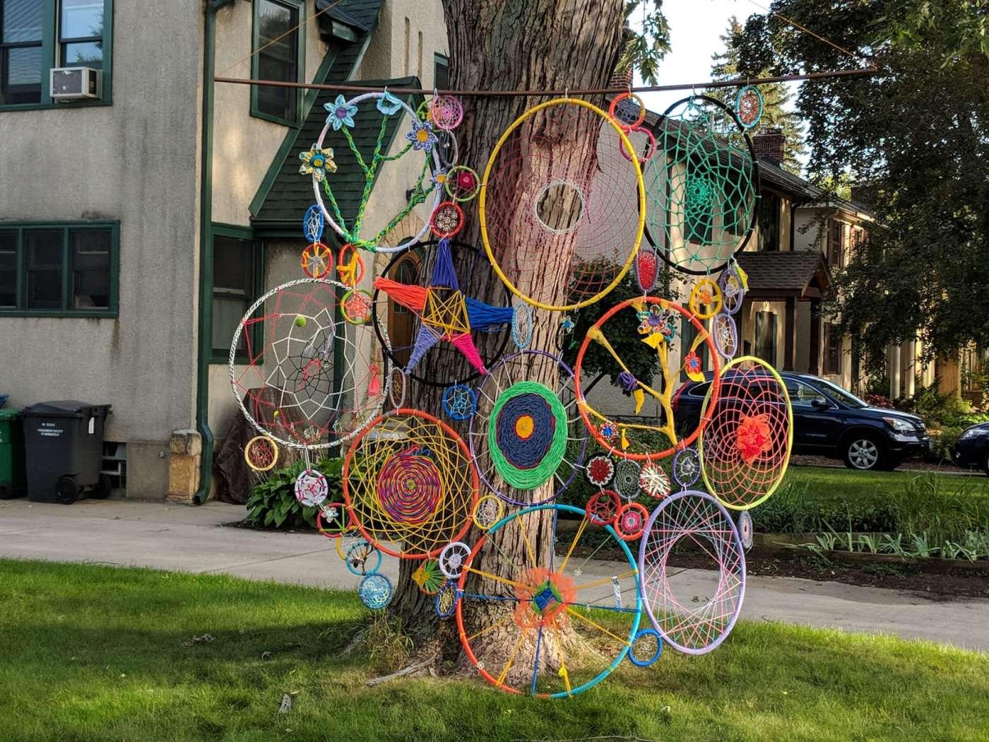 Outdoor yard art on hanging hoops against tree