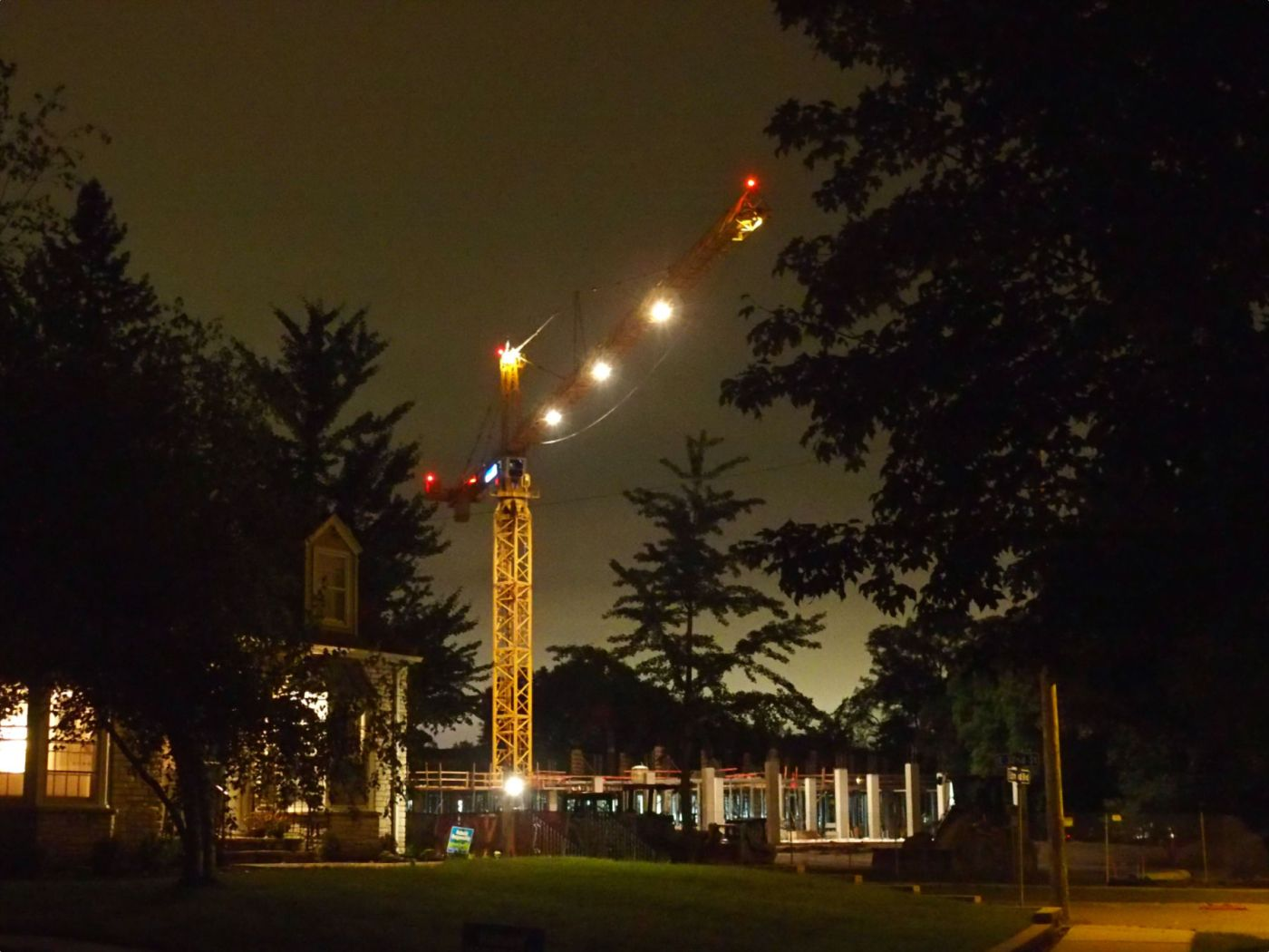 Crane over construction site at night